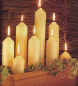 church candles alight in pot